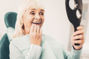 woman happy with her new dentures